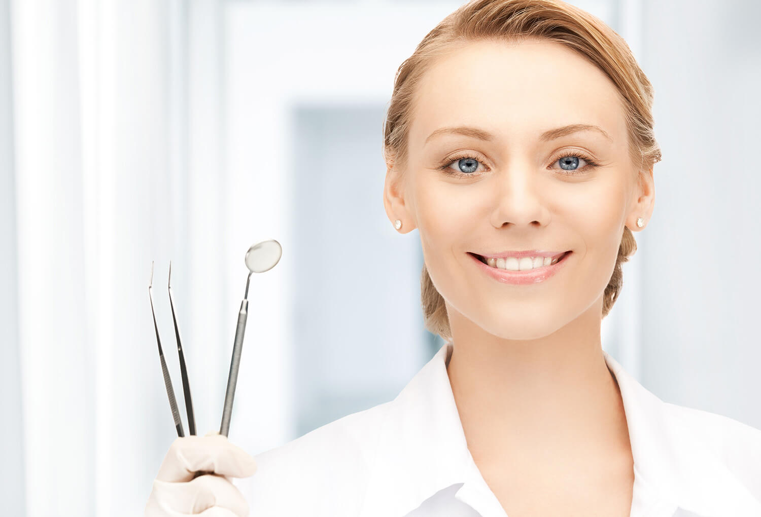 dentist with tools